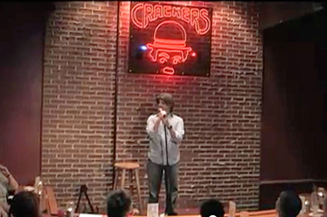 comedian Stewart Huff on stage