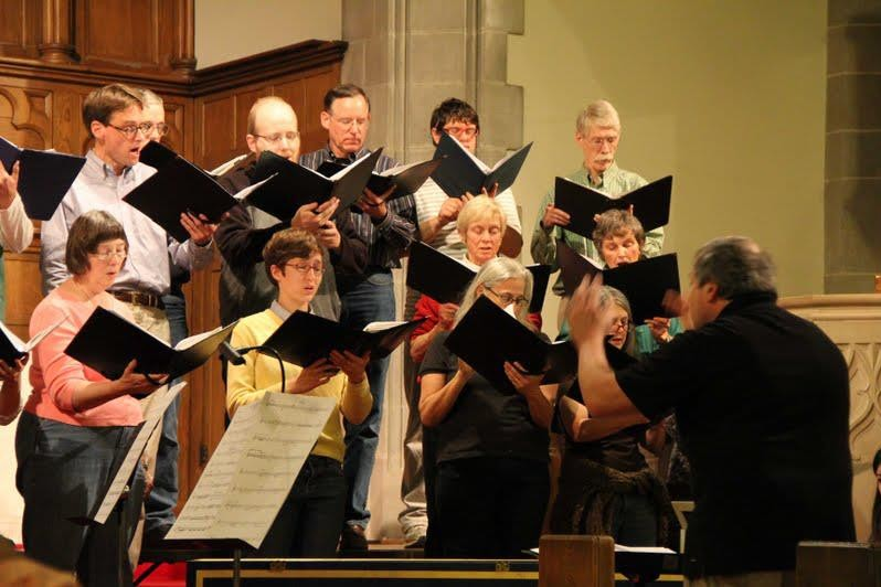 a man conducts a choir