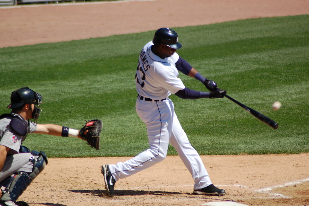Man hitting a baseball.