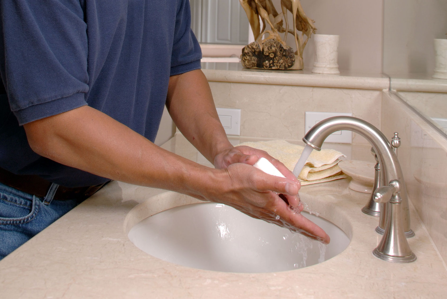 A man washing his hands.