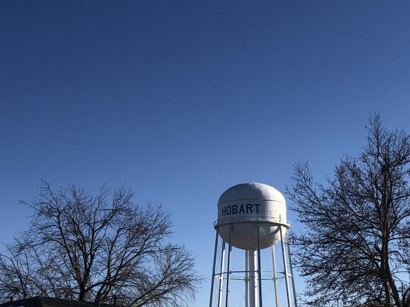 A water tower with the name Hobart against a blue sky