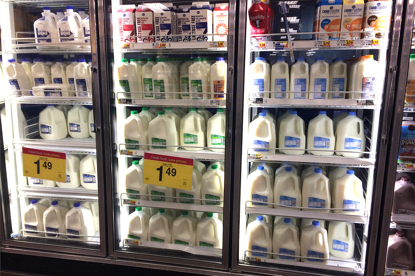 A grocery store reach in cooler filled with milk