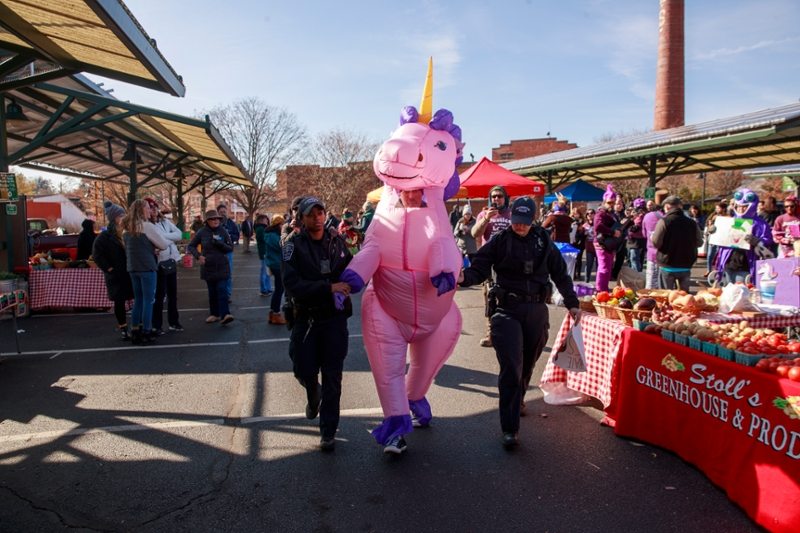man dressed in inflatable pink unicorn costume