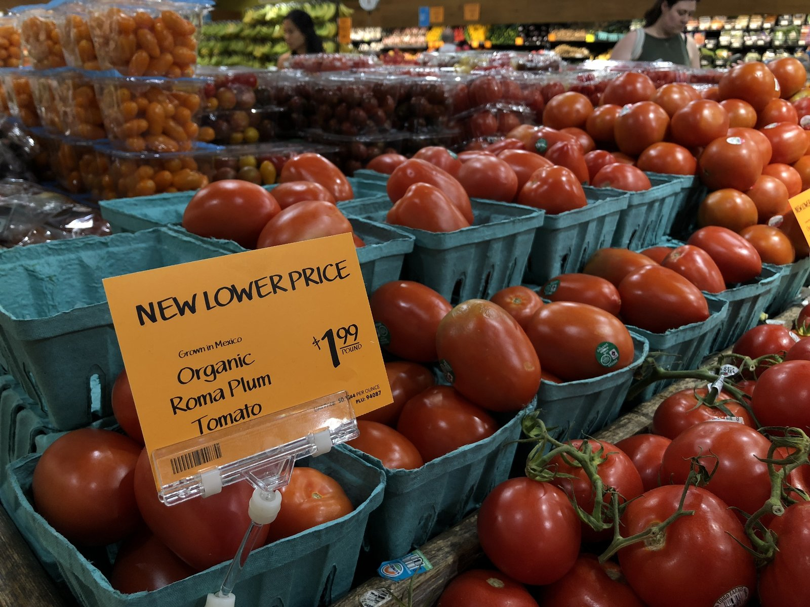 A variety of tomatoes for sale at a grocery store
