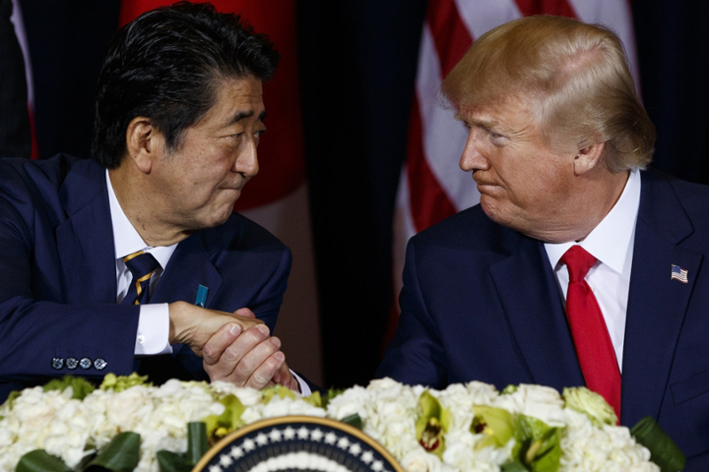 President Trump shaking hands with Japanese Prime Minister Shinzo Abe