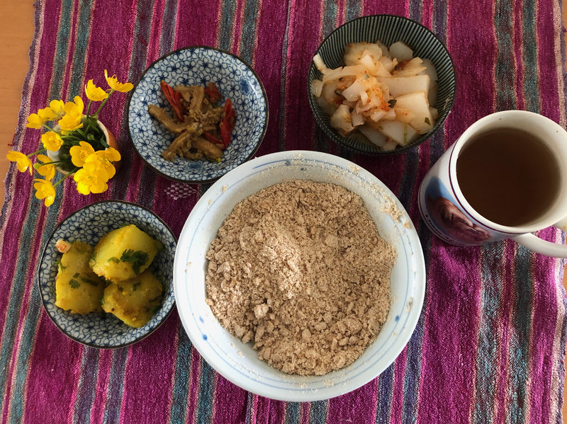 Tsampa flour with other Tibetan lunch dishes.