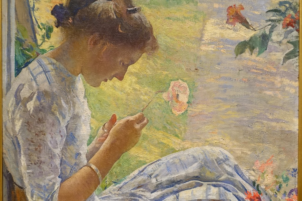 "Close up of the painting ""Mercie Cutting Flowers"" by Edmund Charles Tarbell, 1912."