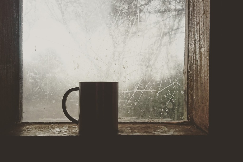 Coffee mug on a winter windowsill.
