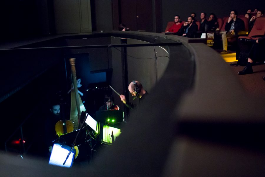 musicians in the pit playing the movie score