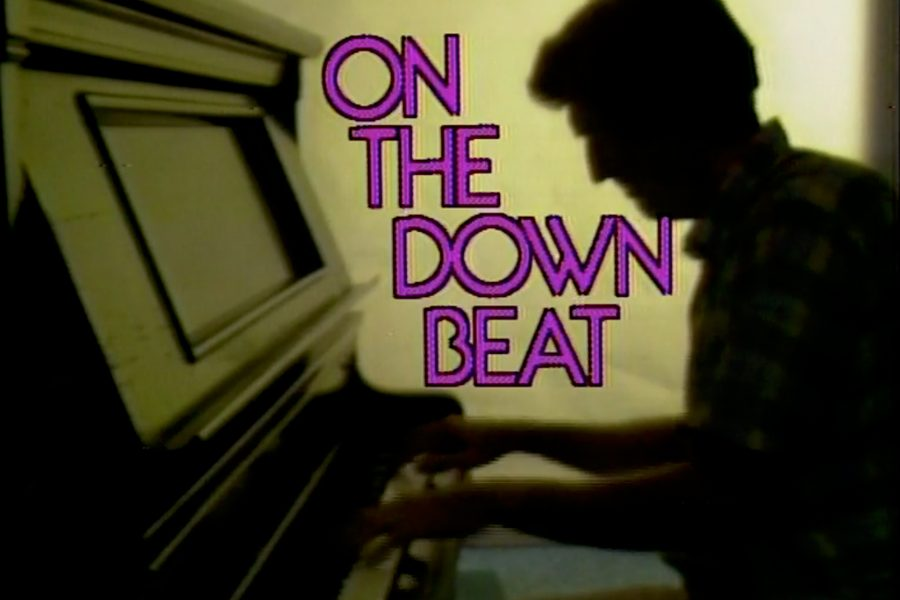 On the Downbeat's title slate featuring the silhouette of a man playing piano.