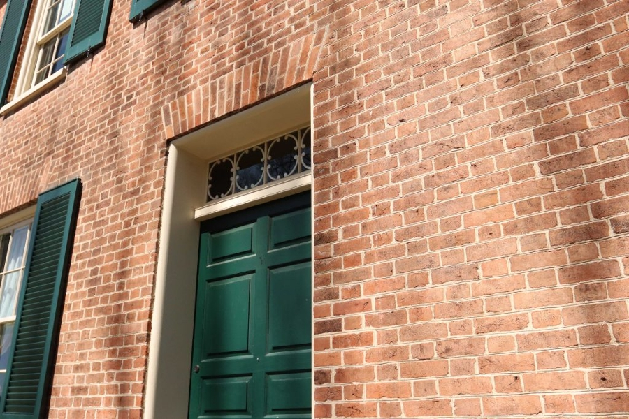 Wylie House brick wall green door