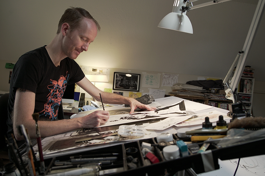 Nate Powell at drawing table