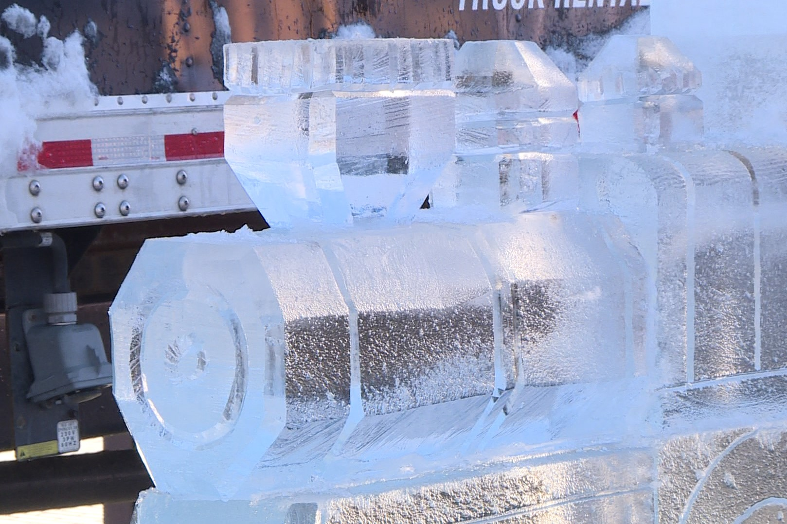 An ice sculpture being prepared for Bloomington's first FreezeFest.