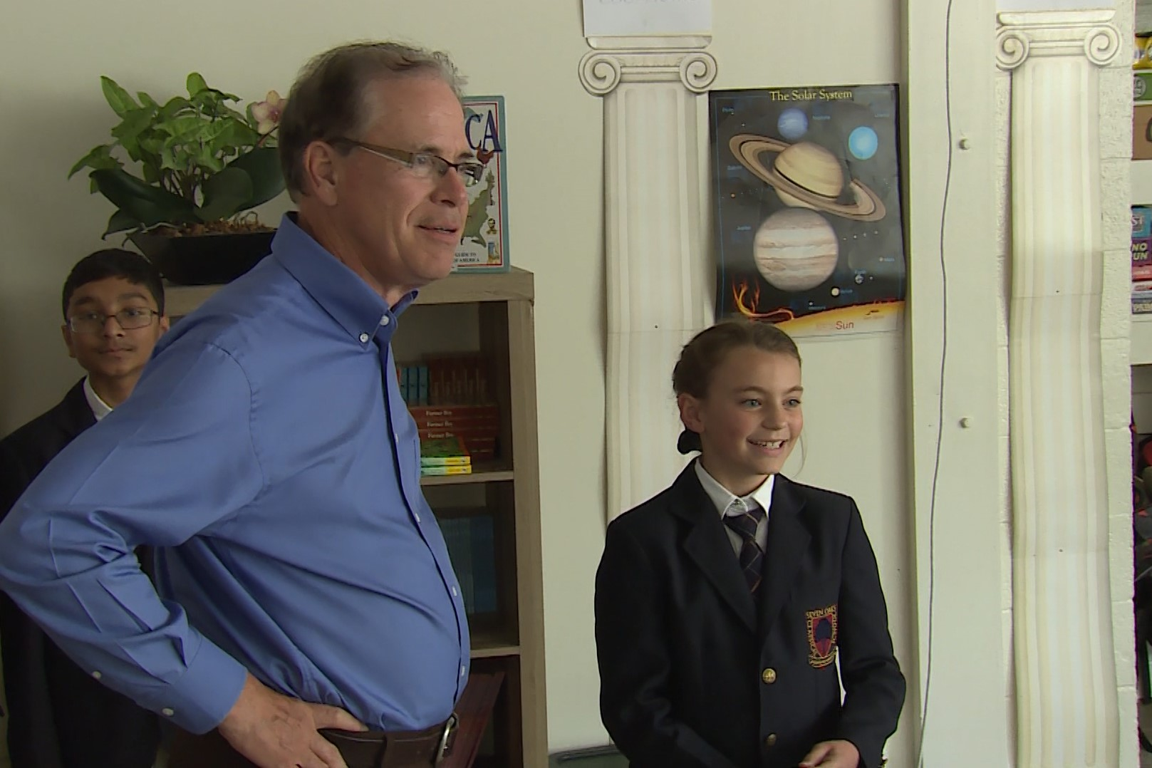 U.S. Senator Mike Braun talks with a student at Seven Oaks Classical School.