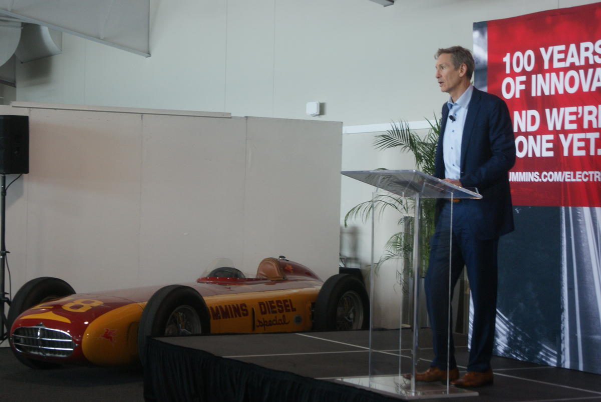 Cummins Inc. Chairman and CEO Tom Linebarger stands at a podium.