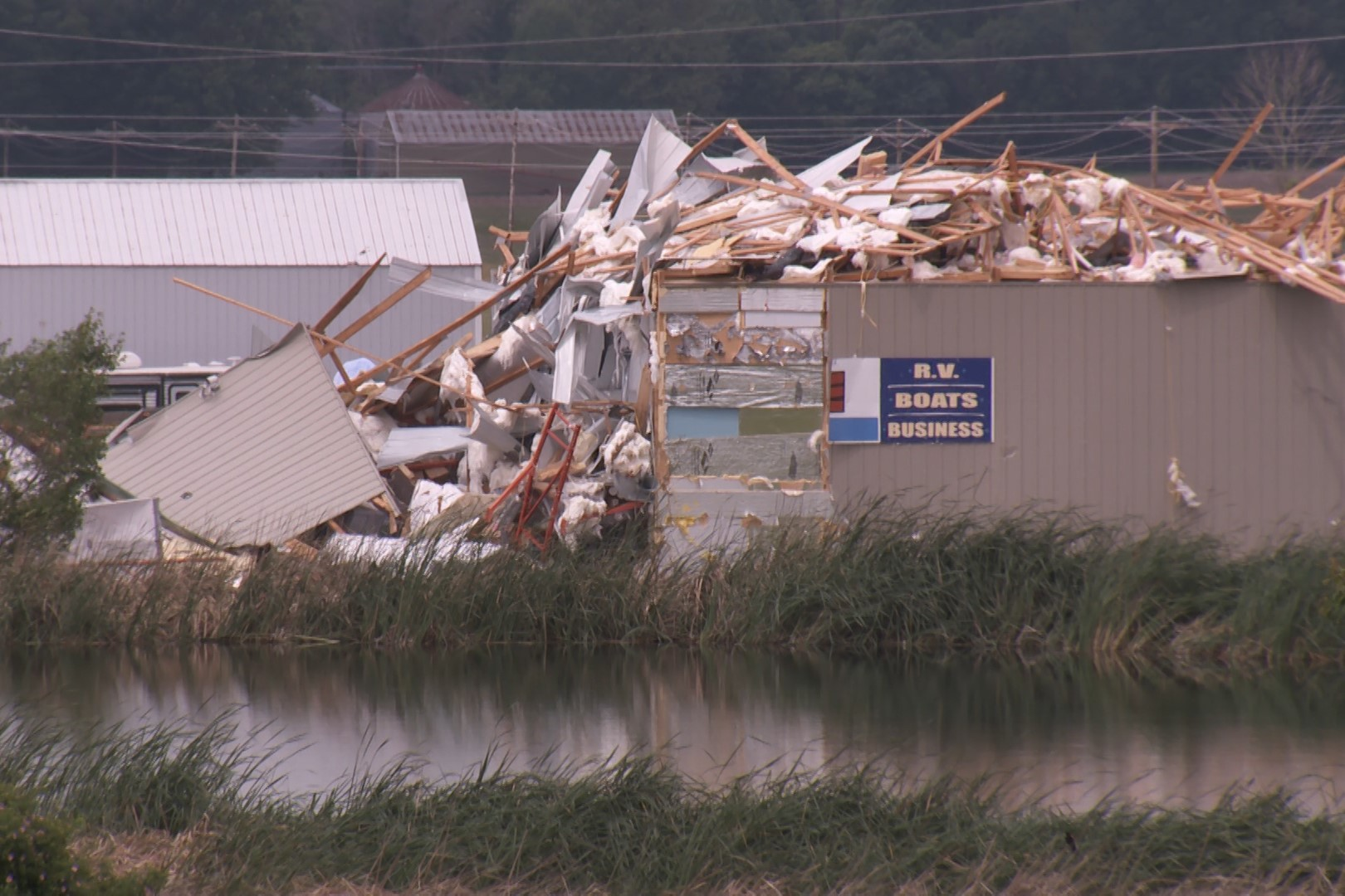 Damage to a building in Ellettsville following severe weather.