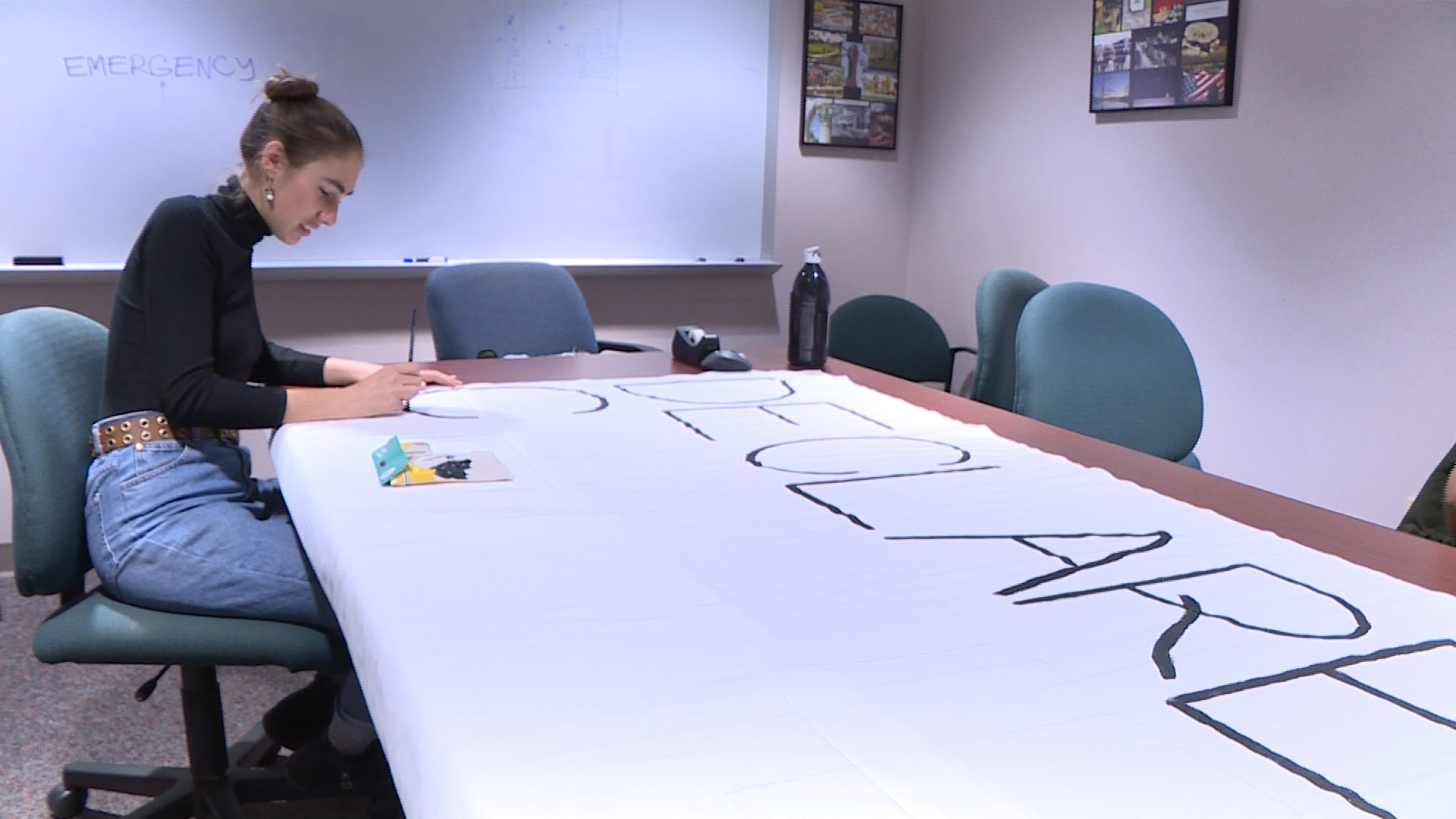 IU student working on banner about climate change