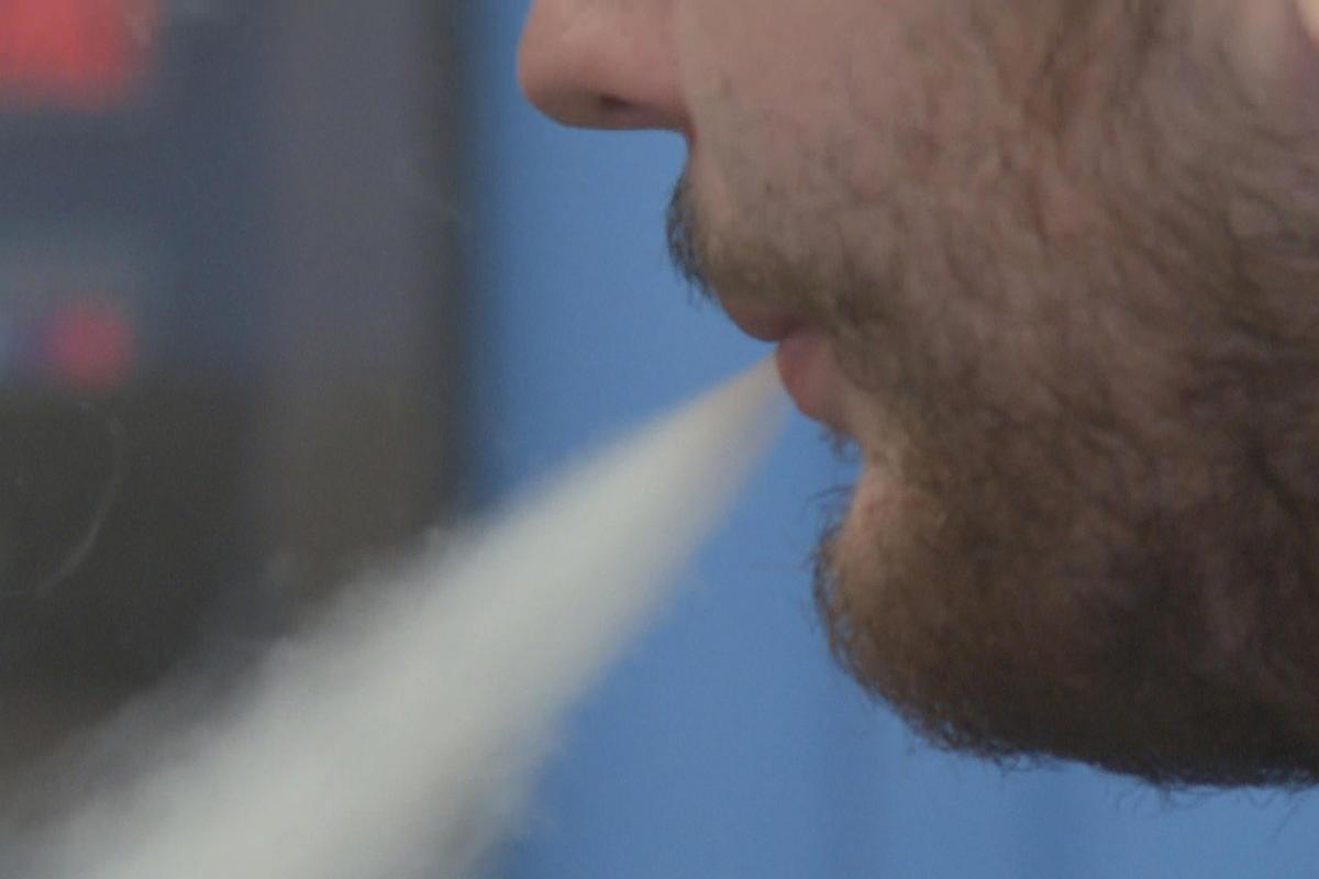 man exhaling from ecig