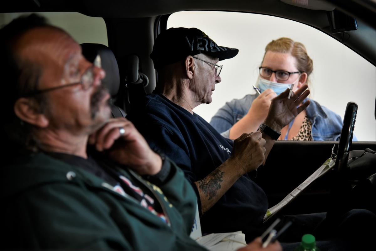 Workers get information about job openings at a drive-thru employment fair in Elkhart during the pandemic.