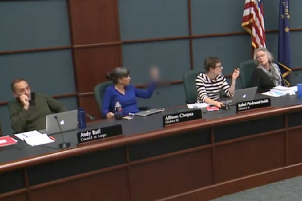 City Council Member Allison Chopra is seen making an obscene gesture during a City Council meeting, Tuesday, Oct. 22, 2019.