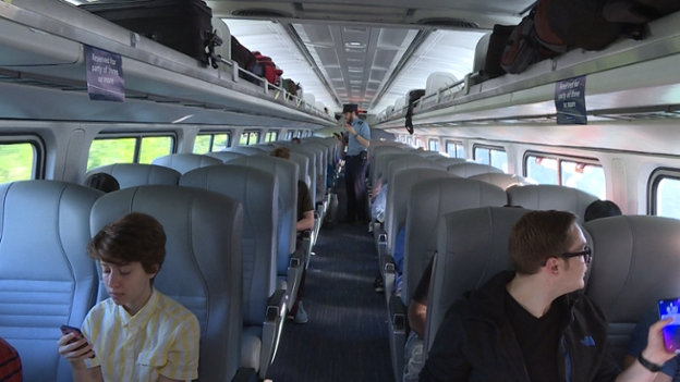 Passengers relax aboard Amtrak's Pere Marquette train