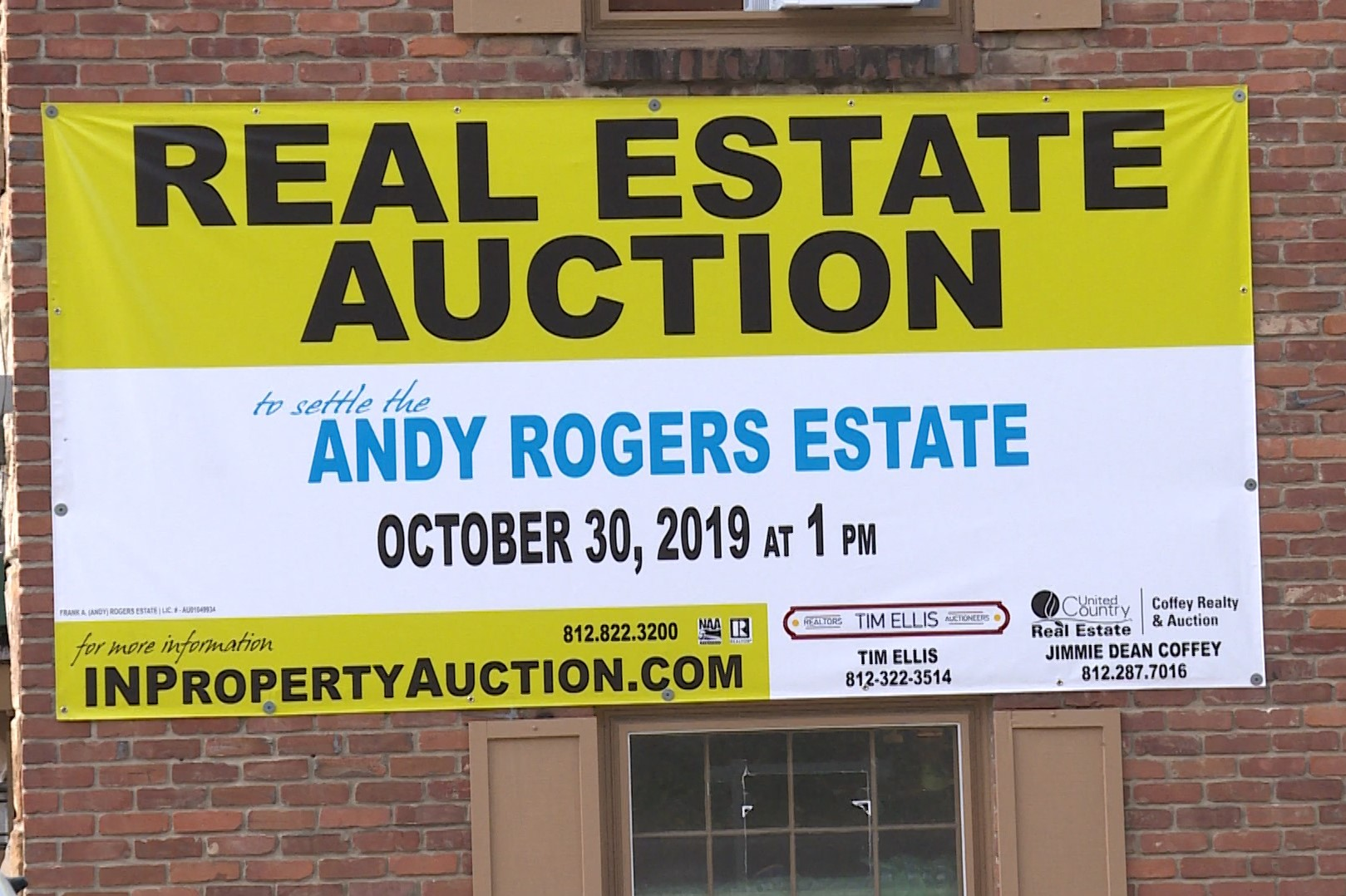 A sign for the auction of multiple properties in Brown County. Sept. 19, 2019.