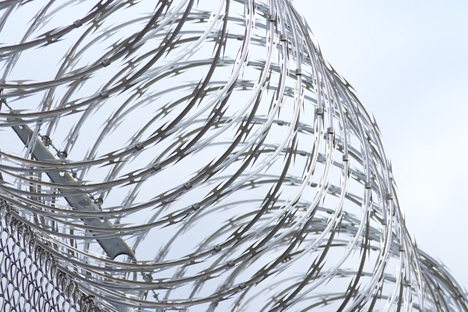 Generic barbed wire outside a prison.