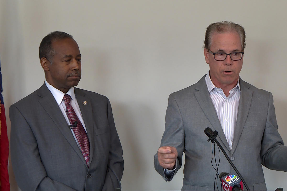 HUD Secretary Ben Carson, left, and Sen. Mike Braun (R-Ind.) discuss opportunity zones in Indianapolis.