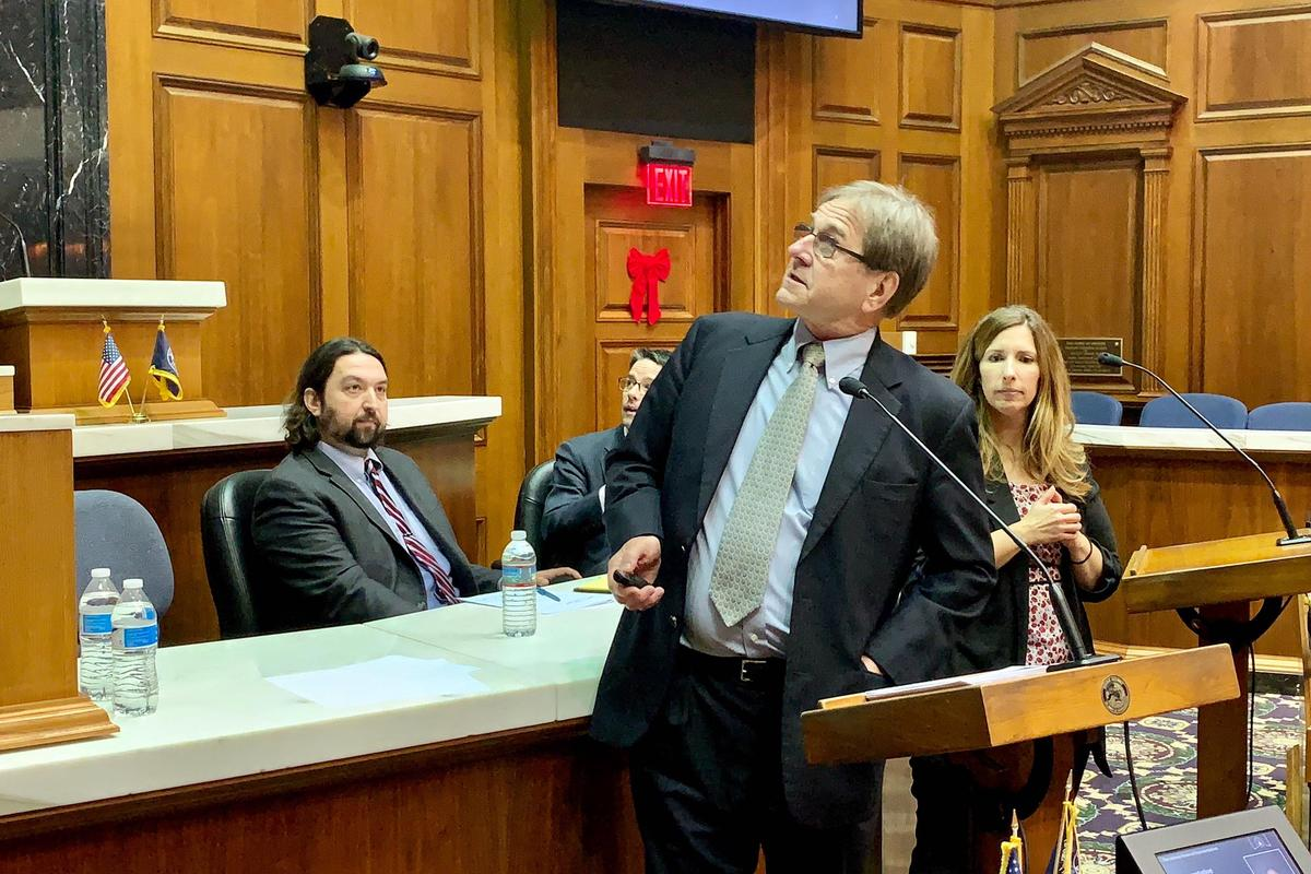 Attorney Bill Groth, center, discusses his election security presentation as Butler Professor Greg Shufeldt, left, looks on.