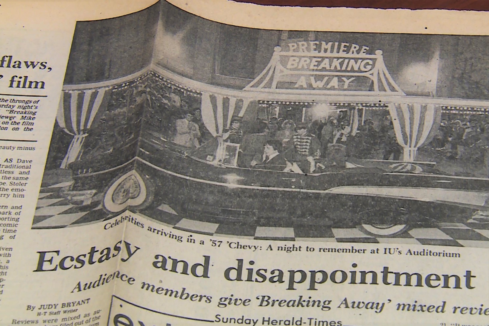 "Newspaper clipping about breaking away reads ""ecstasy and disappointment"""