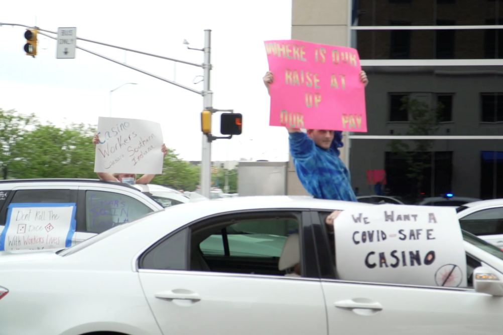Casino workers hold signs from their cars in downtown Indianapolis
