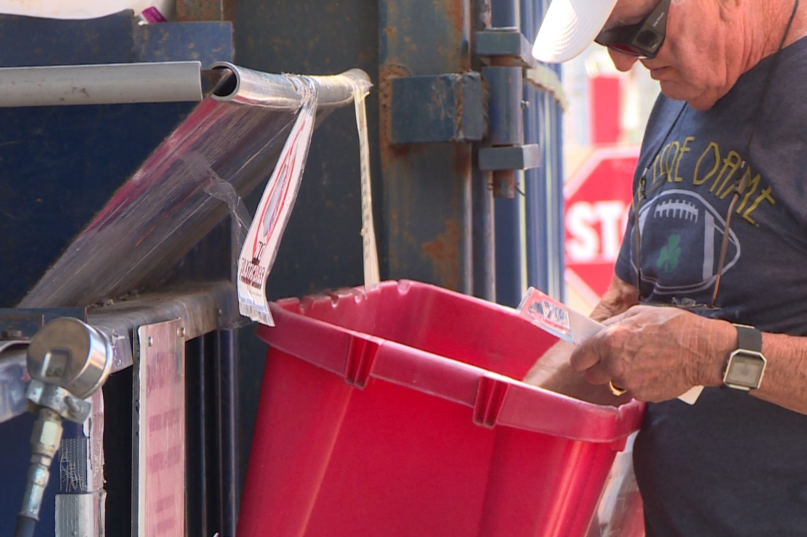 Man recycles at solid waste management district