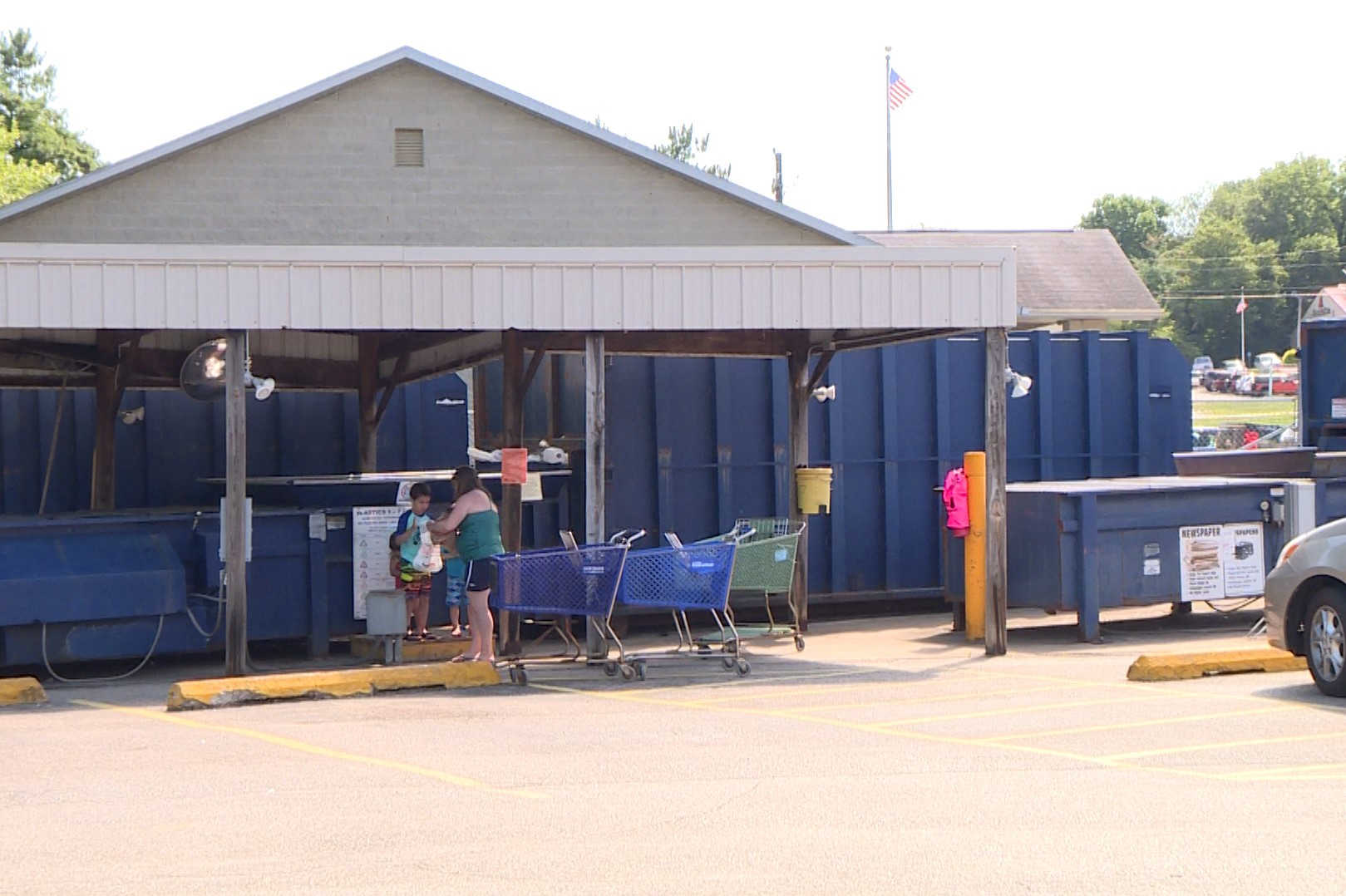 Family sorts recycling as solid waste management district