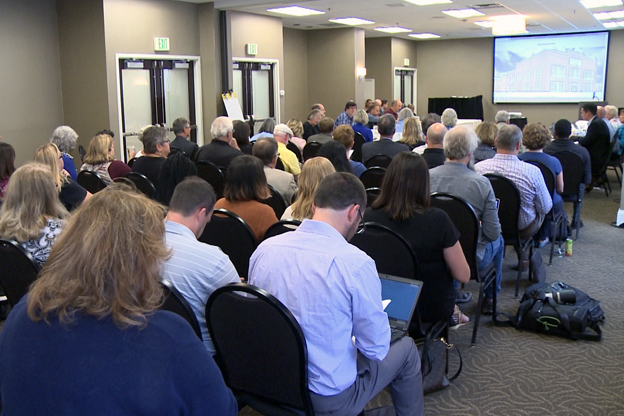 Stakeholders fill the meeting room for the convention center expansion