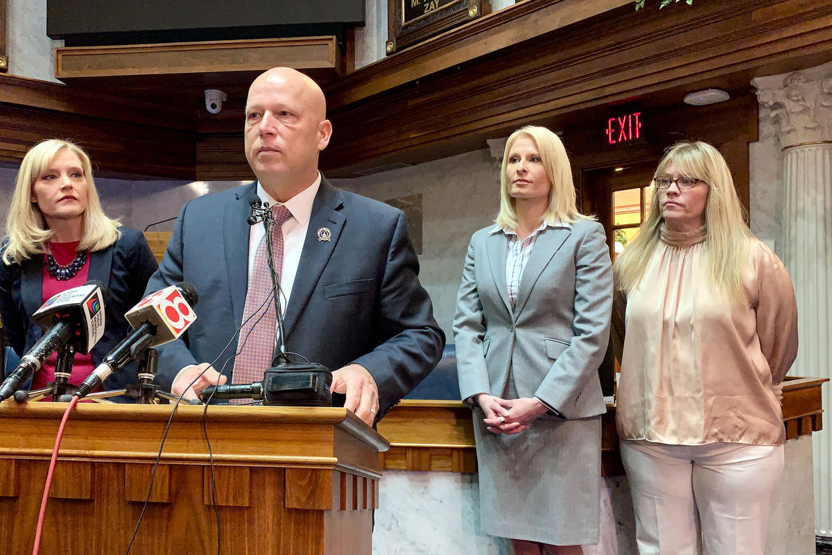 Sen. Mike Crider (R-Greenfield) talks about his legislation with Sen. Erin Houchin (R-Salem), left, and sexual assault prevention advocates supporting him.
