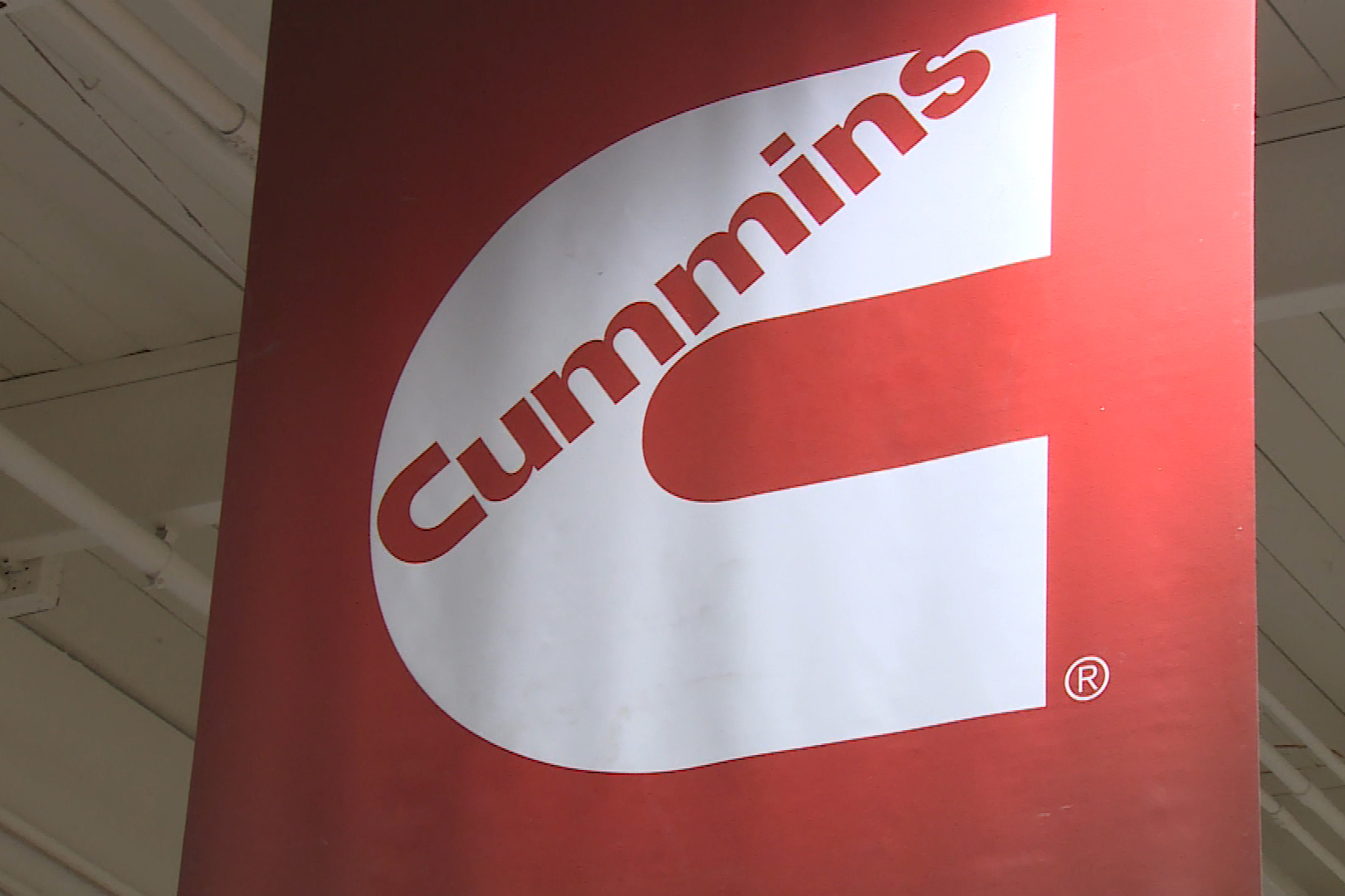 The Cummins logo on a red banner.