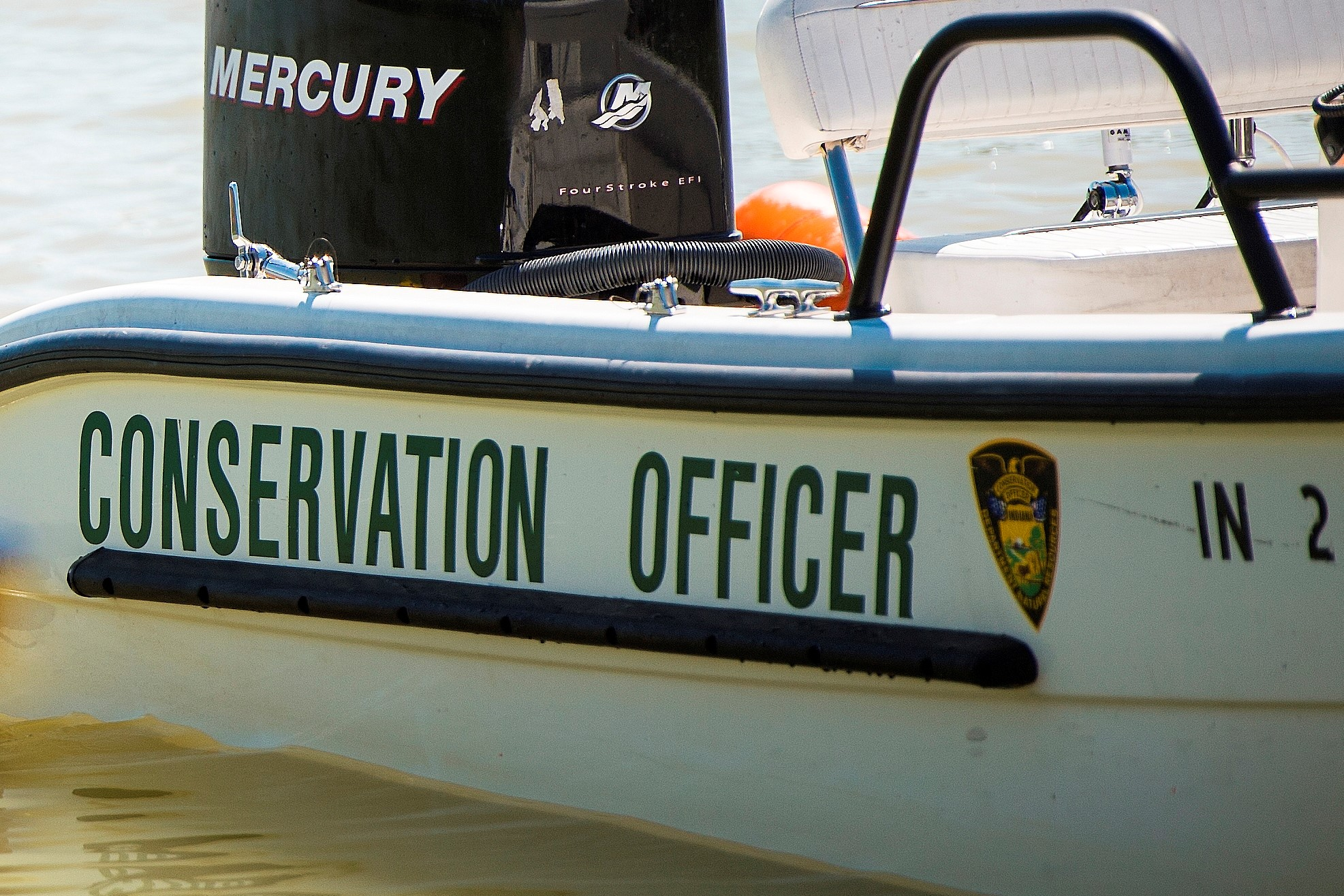 A DNR conservation officer's boat on the water.