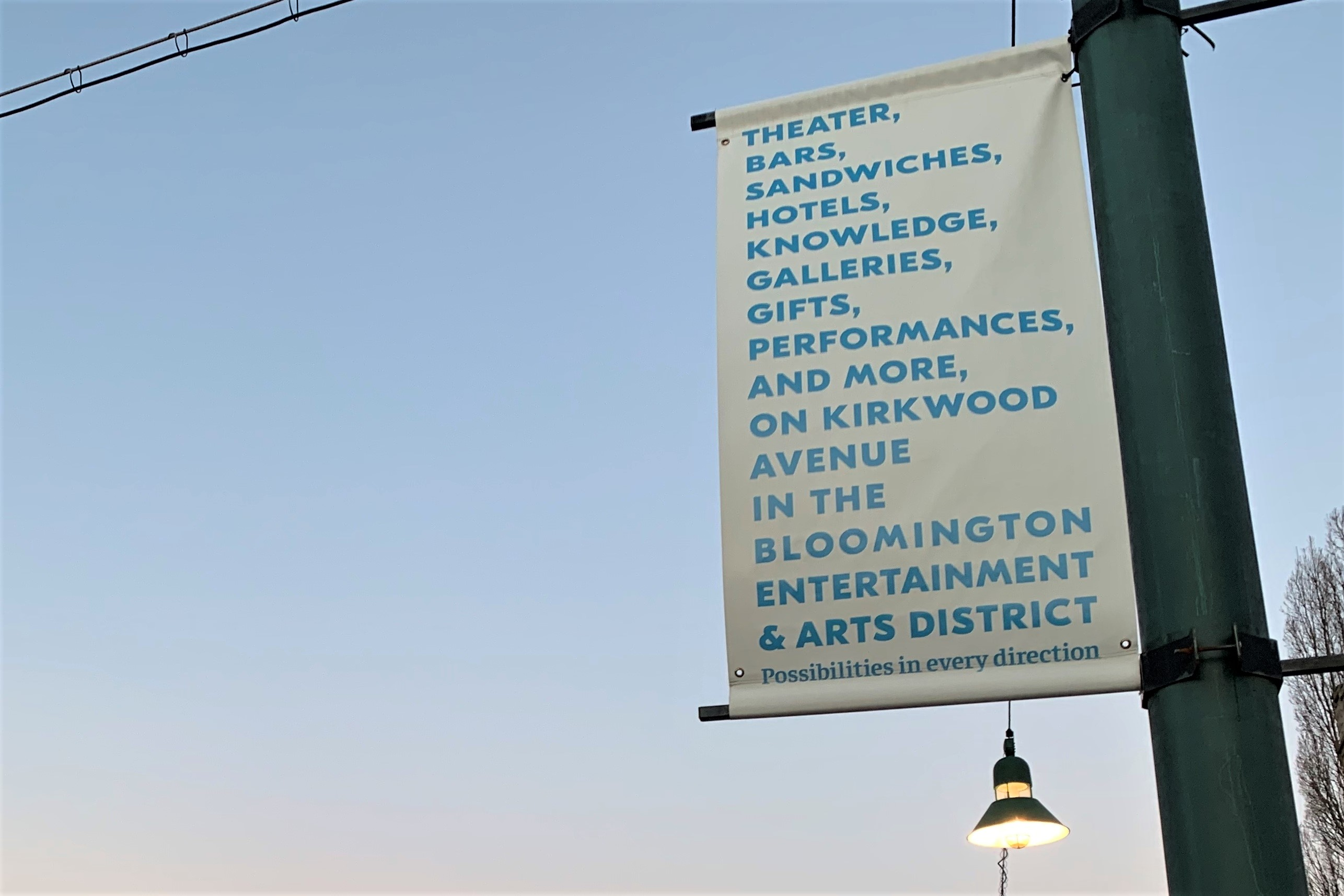 A downtown Bloomington arts and restaurants tourism sign.