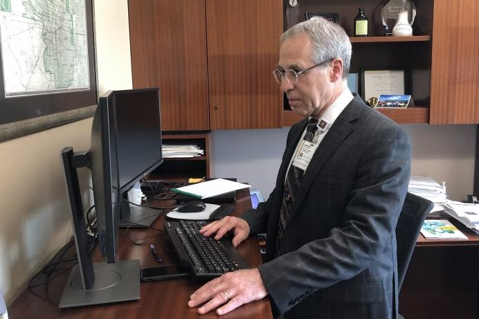 Dr. Jonathan Gottlieb, IU Health's Chief Medical Officer, stands at a computer.