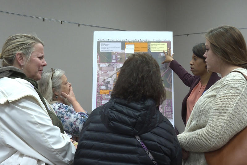 Franklin residents talk with officials at the Environmental Protection Agency about the contamination at an open house on Dec. 3.