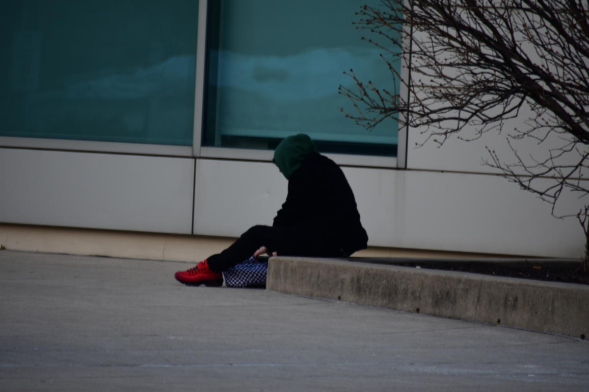 A person experiencing homelessness.