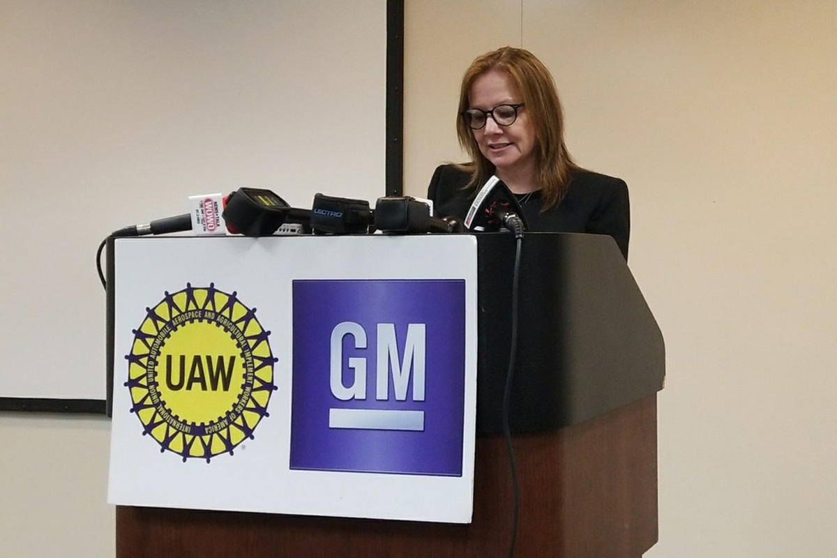 General Motors CEO Mary Barra speaks at a podium.