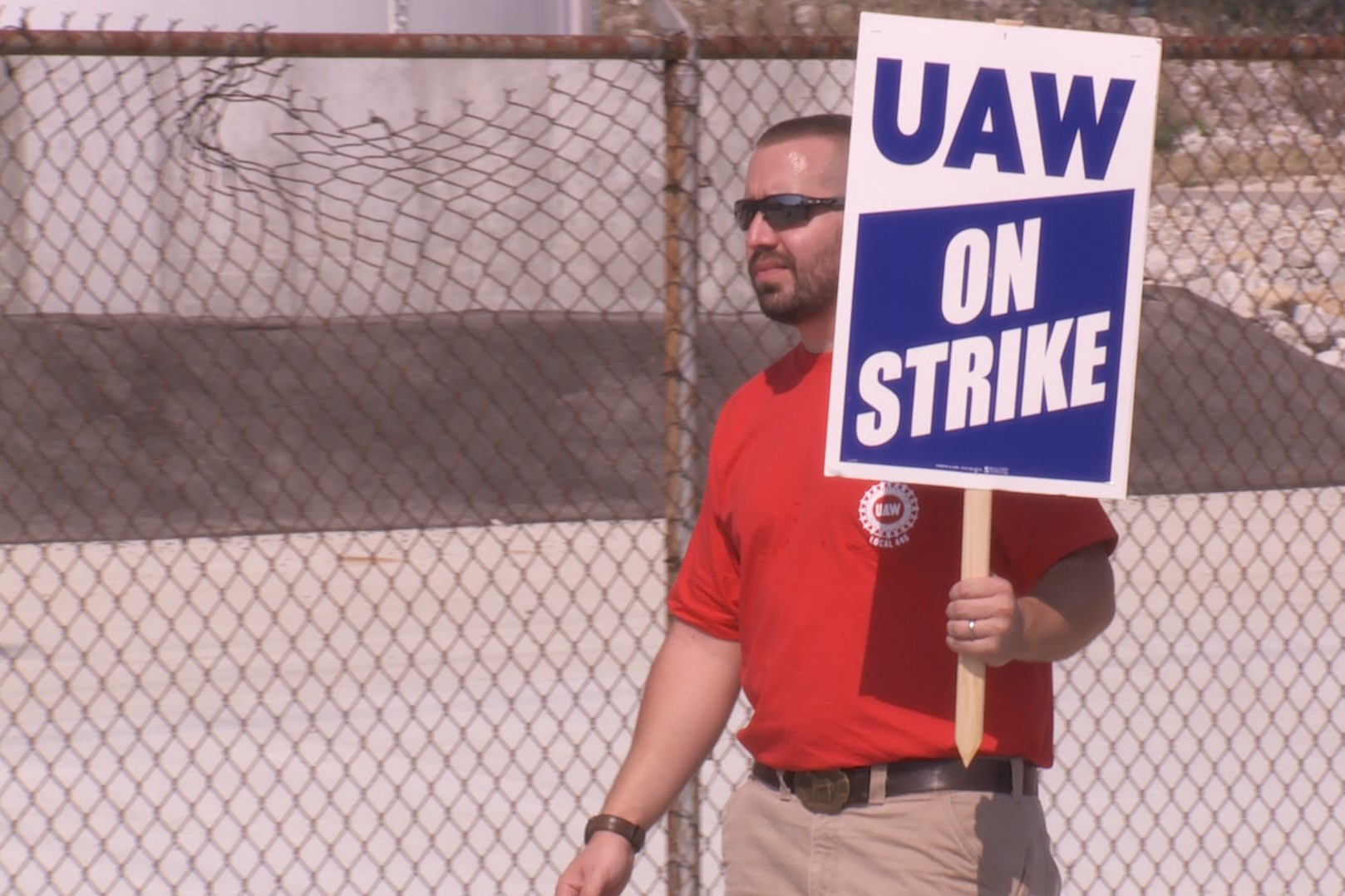 A UAW member walks the picket line outside the GM plant in Bedford.