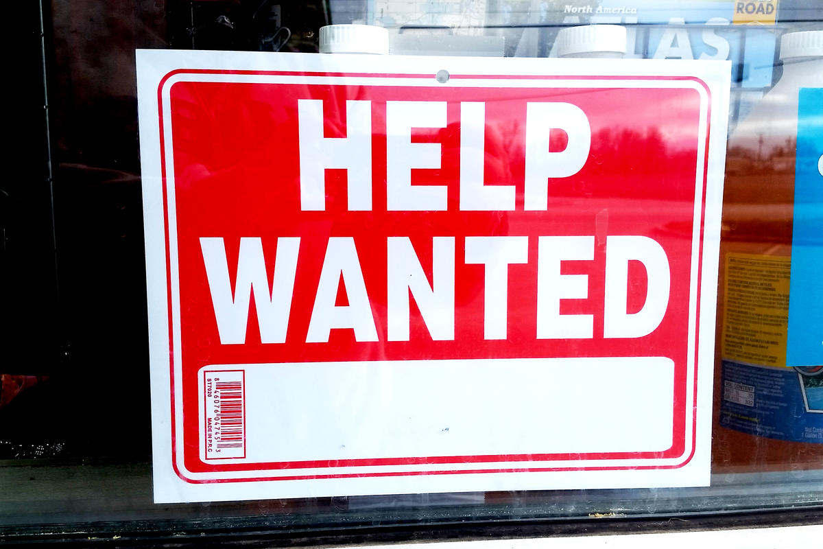 "A red ""help wanted"" sign."