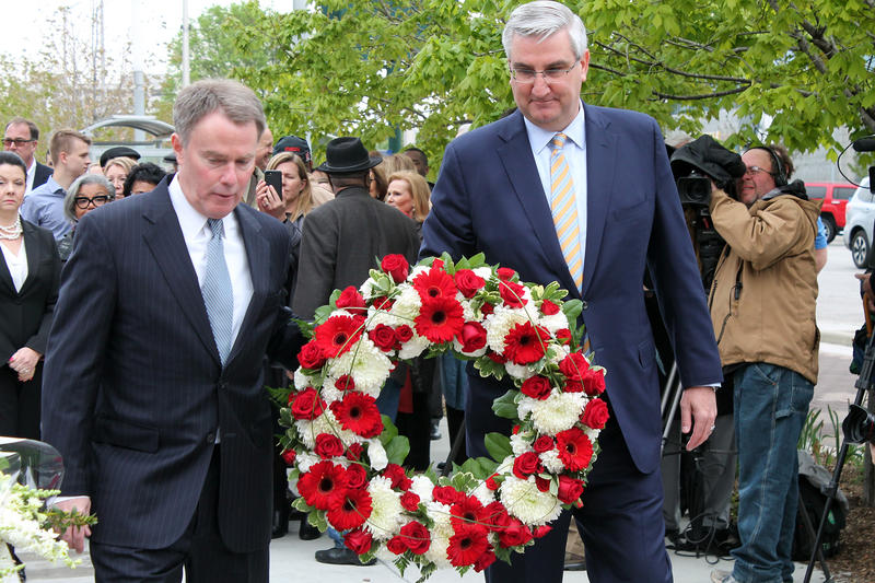 Indianapolis Mayor Joe Hogsett and Gov. Eric Holcomb lay a wreath at Richard Lugar Plaza in Indianapolis.