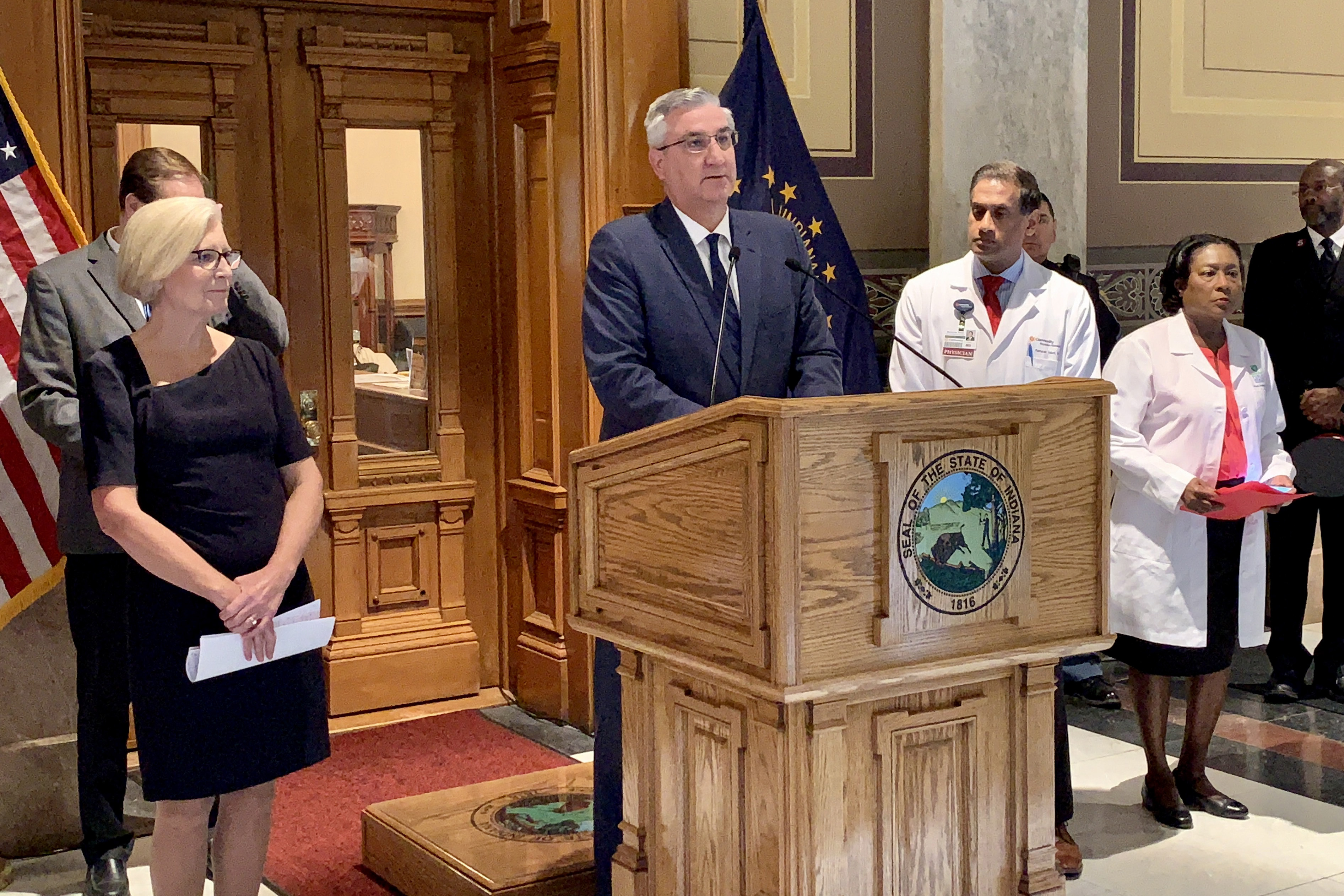 Gov. Eric Holcomb announces a Marion County woman is Indiana's first COVID-19 death.