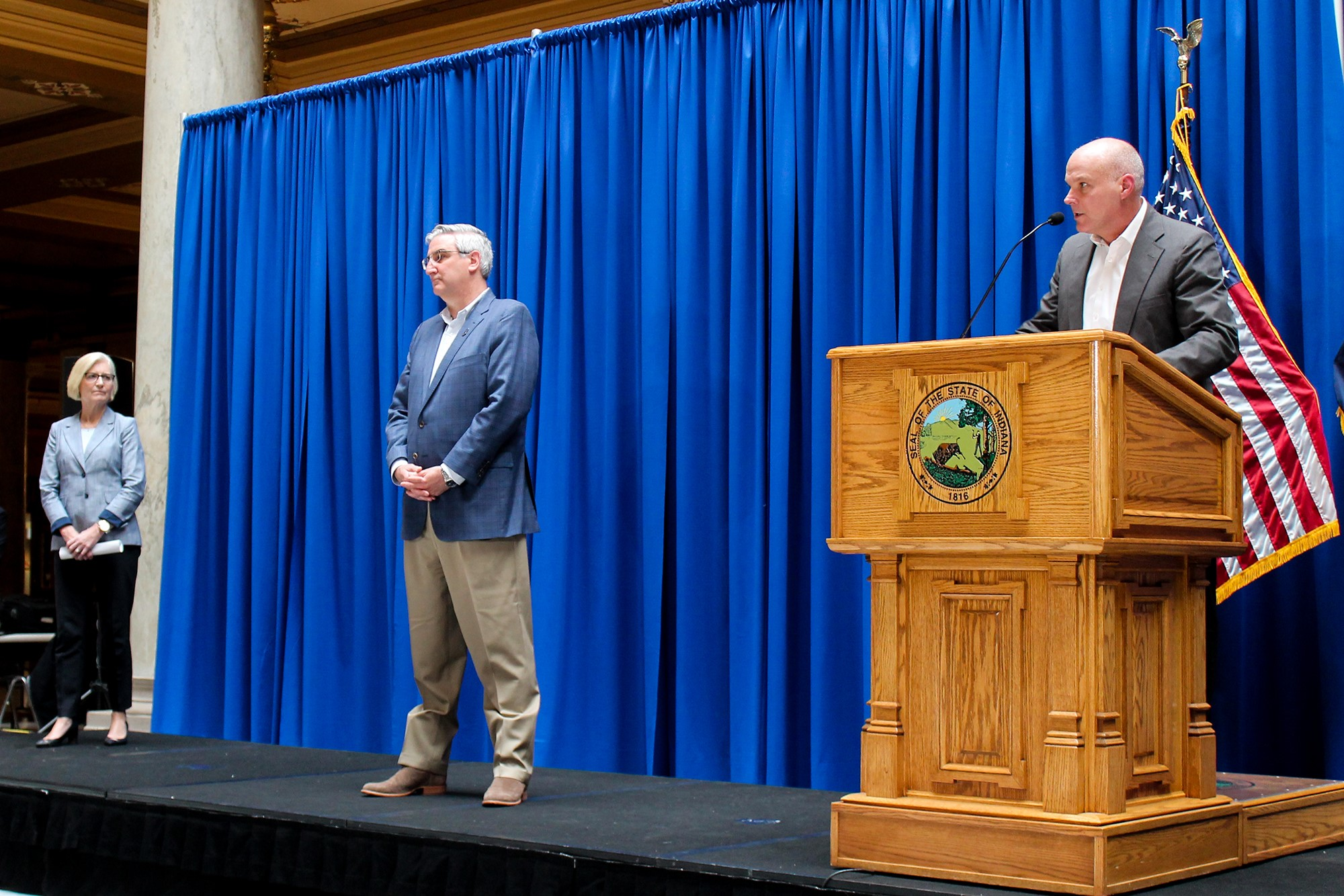 Gov. Eric Holcomb and Kris Box addressing the public.