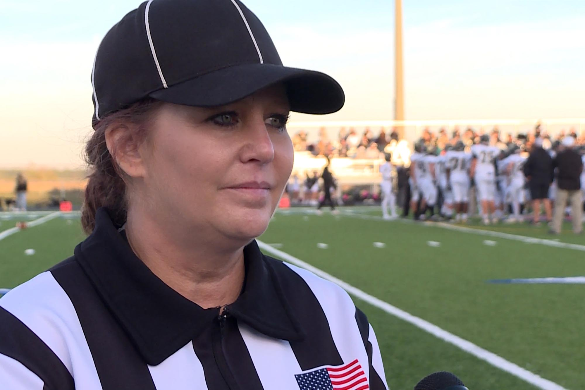 Holly McCammack is one of about a dozen licensed football officials, and usually is on the field officiating with her husband.