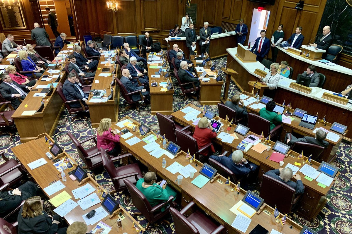 Lawmakers seated in the indiana house chambers in an aerial view