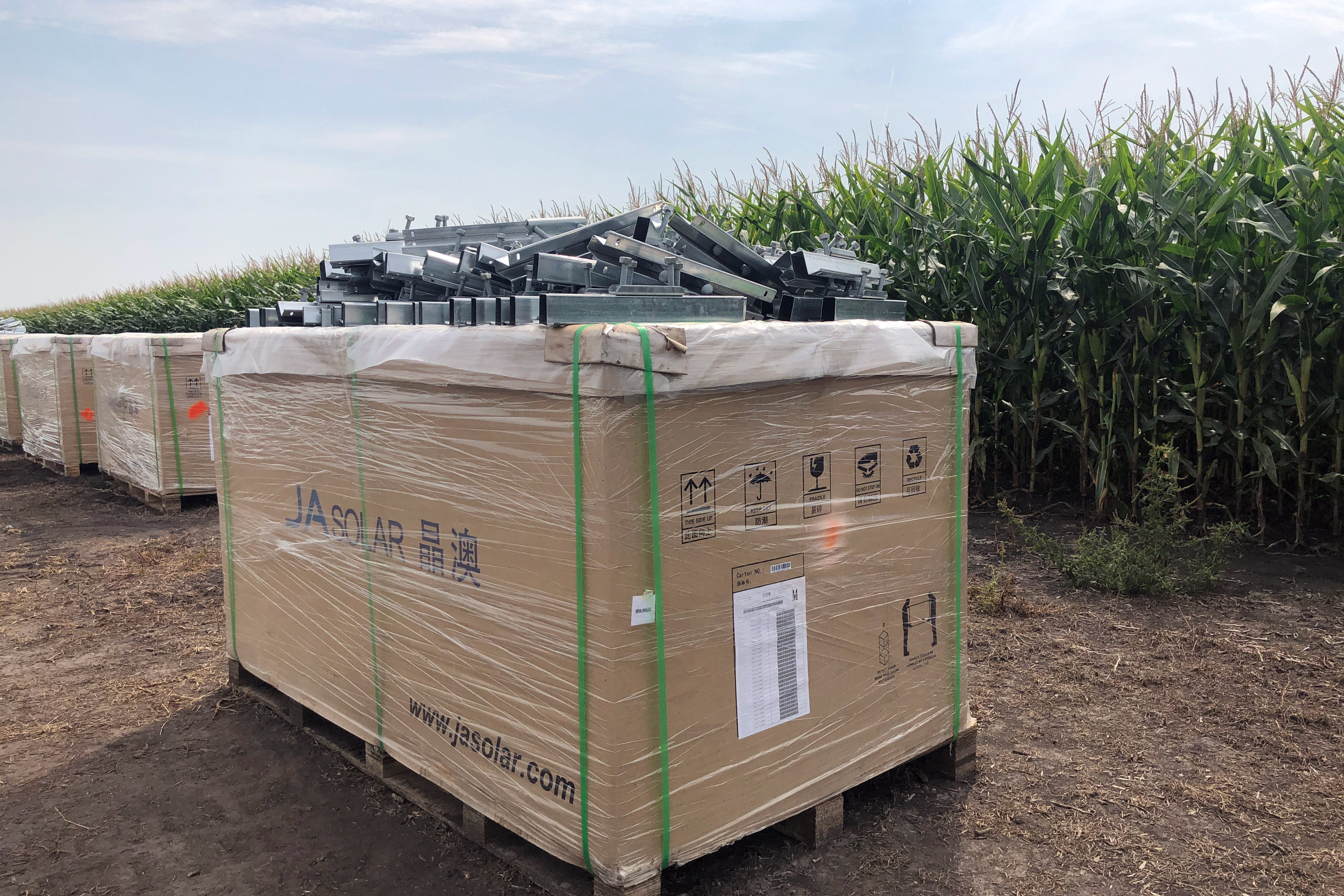 A box of solar panels waiting to be installed in a field in Indiana.
